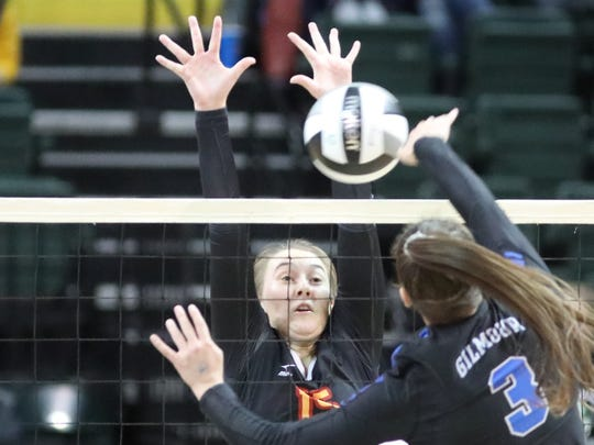 Bishop Fenwick outside hitter  Julia Gardon (15) gets a block during their state semifinal against Gilmour Academy Thursday, Nov. 7, 2019.