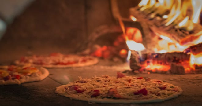Pizza in the wood-fired ovens of Catch-a-Fire Pizza in Oakley