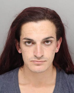 Jason A. Hassebrock is in Hamilton County Detention Center on four burglary charges. Court documents accuse the 25-year-old of sneaking into dorm rooms on the University of Cincinnati's campus while people were asleep in their rooms.