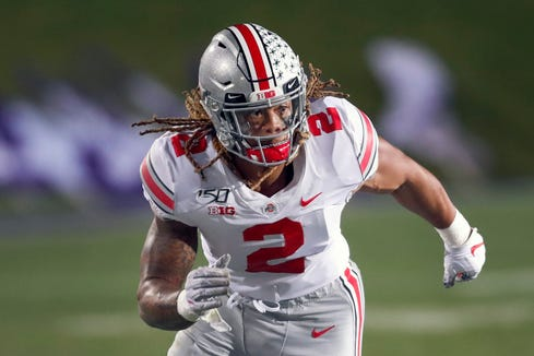 In this Oct. 18, 2019, file photo, Ohio State defensive end Chase Young rushes against Northwestern during the second half of an NCAA college football game, in Evanston, Ill. Ohio State says defensive end Chase Young won't play Saturday against Maryland due to possible NCAA violation in 2018.