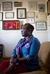 Yolonda Williams, an Army veteran, sits for a portrait in her office she has adorned with the accolades and awards she accumulated during her 25 year career in the military at the Williams home in Clarksville, Tenn., on Friday, Nov. 8, 2019.