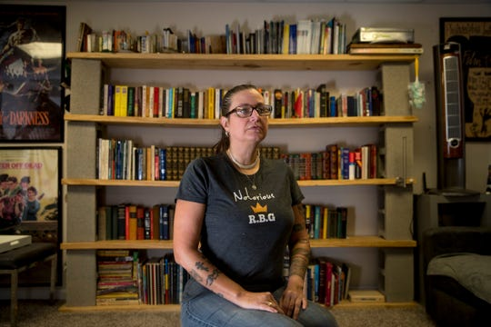 Nikki Prodromos, a retired veteran that runs a nonprofit providing drug and alcohol counseling to veterans, sits for a portrait in front of her wall of books that range from a collection of letters from U.S. presidents to her old Army field books at the Prodromos home in Adams, Tenn., on Wednesday, Nov. 6, 2019.