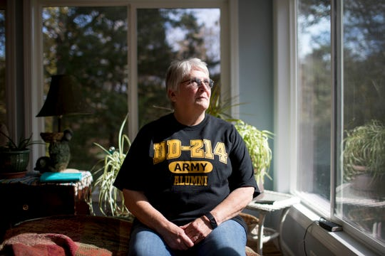 Mary Ross, an Army veteran, sits for a portrait in her closed patio sun room at the Ross Household in Clarksville, Tenn., on Monday, Nov. 4, 2019.