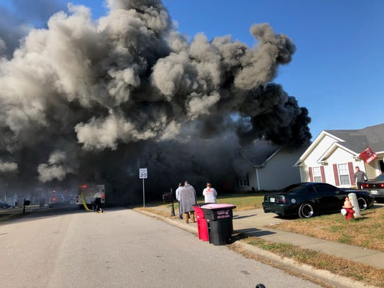 An Oakmont Drive home engulfed in smoke after two men were inside asleep as the house caught fire. The two men and a dog evacuated safely on Nov. 8, 2019.