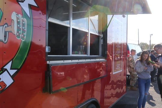 Taco fans wait to get their taco fix outside the Fatboy Taco truck, which reopened Tuesday after it was totaled in a car wreck in April.