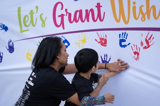 "A ""Wish Wall"" for attendees to make donations and leave a lasting, colorful impression."