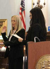 Patricia Gusmano, a nearly 30-year law enforcement veteran, being sworn in as Union County Prosecutor's Office's first female chief detectives.