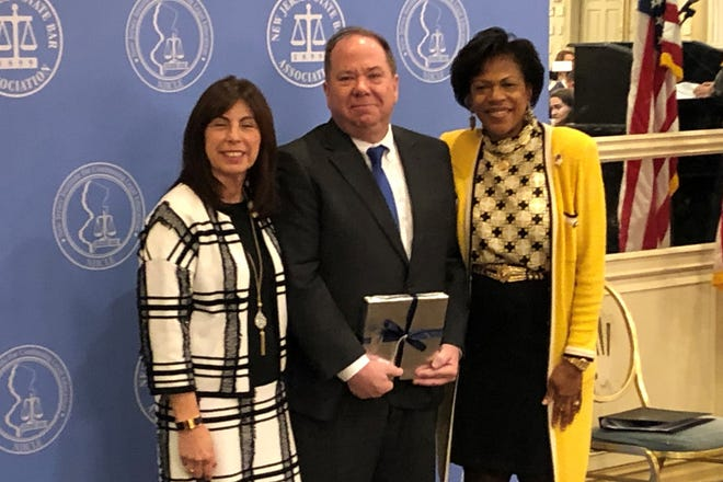 James McGlew II, a partner with Lindabury, McCormick, Estabrook & Cooper, P.C., was honored by the New Jersey State Bar Association at the NJ Commission on Professionalism in the Law annual awards luncheon as the Union County Bar Association's Professional Lawyer of the Year on Wednesday, Oct. 23, at Pines Manor in Edison, NJ. Pictured (left to right): Chief Judge Freda L. Wolfson of the United States District Court for the District of New Jersey, Lindabury's James McGlew II, and NJSBA Chair Karol Corbin Walker.