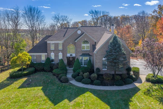 A brick front Colonial sited on over an acre of open and wooded privacy in Bethlehem Township's Hunterdon Ridge neighborhood is for sale for $559,900.