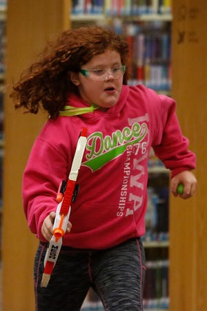 Before COVID-19, back when the Indianola Public Library was offering full services, the library hosted a family after-hours Nerf battle. This warrior is heading back to home base with the prize on Nov. 7, 2019.