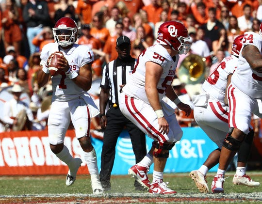 Oklahoma quarterback Jalen Hurts (1) throws in the pocket against Texas on  Saturday, Oct. 12, 2019, in Dallas.