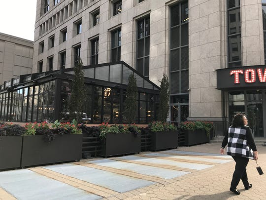 The Townhouse restaurant at the One Detroit Center skyscraper in downtown Detroit is an example of how we've been adding new ground-floor retail where it didn't exist before to generate more street life and visual interest.