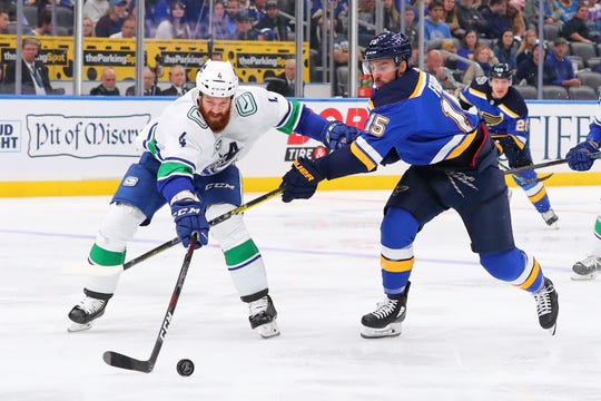 Robby Fabbri, right, fights Jordie Benn for the puck Oct. 17, 2019 in St Louis.