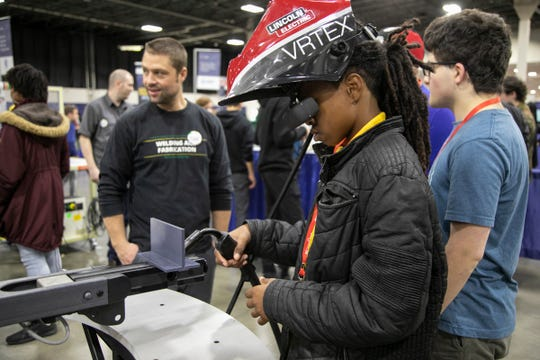 Charenzo Harris, 15, of Chandler Park high school uses a virtual reality welder used for training purposes presented by Washtenaw Community College as thousands of Metro Detroit students participate in MiCareerQuest Friday, Nov. 08, 2019 at the Suburban Collection Showplace in Novi. Over 100 exhibiting organizations showcase more than 200 in-demand jobs in four career quadrants.