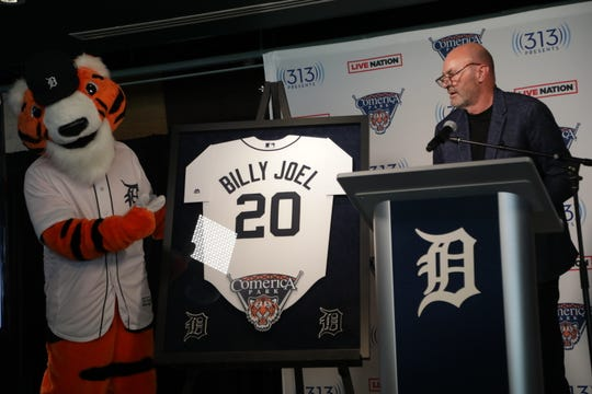 Paws helps Tiger legend Kirk Gibson announce Billy Joel concert set for July 10 2020 at Comerica Park.