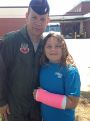 Lt. Col. Todd Grant and his daughter Jenna during his Air Force service.