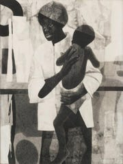 """Mother and Child,"" a 1965 charcoal drawing by Detroit artist Charles McGee, is part of the ""Detroit Collects: Selections of African-American Art from Private Collections"" exhibit at the Detroit Institute of Arts. It is part of the collection of Jerome Watson and Deborah Geraldine Bledsoe Ford."