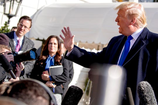 White House deputy press secretary Judd Deere, left, and White House press secretary Stephanie Grisham listen as President Donald Trump speaks to reporters on the South Lawn of the White House, Friday, Nov. 8, 2019, before departing to Georgia to meet with supporters.