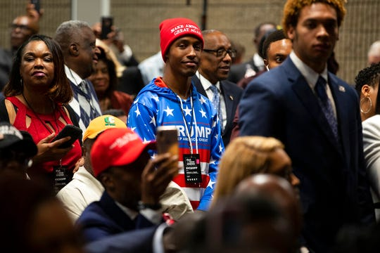 """Supporters of President Donald Trump wait for his arrival to speak during the launch of """"Black Voices for Trump,"""" at the Georgia World Congress Center, Friday, Nov. 8, 2019, in Atlanta."""