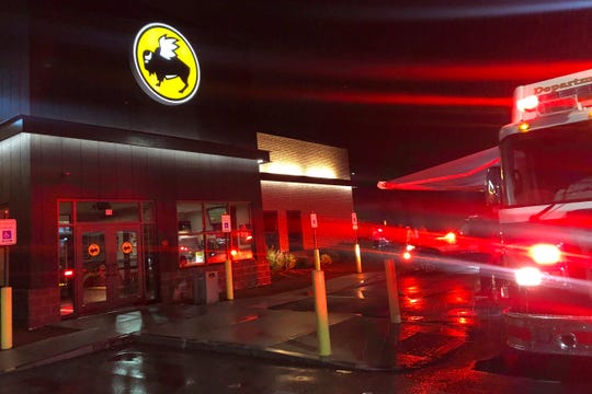 Emergency crews at the Buffalo Wild Wings restaurant in Burlington, Mass. Thursday night. Massachusetts authorities say an employee of the restaurant has died and eight others have been hospitalized following a chemical mixture at the restaurant.