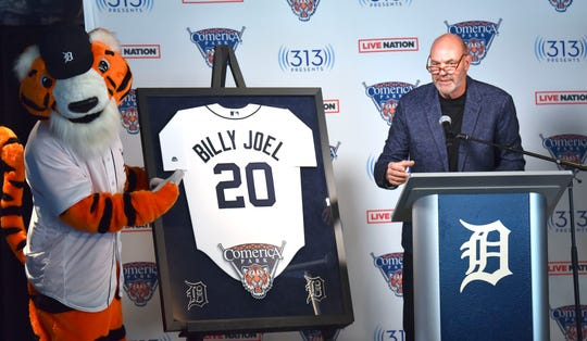 Detroit Tigers mascot PAWS helps Kirk Gibson unveil a Billy Joel jersey as the Tigers broadcaster announces that Billy Joel will perform at Comerica Park on Friday, July 10, 2020. It will be his first-ever concert at the ballpark.