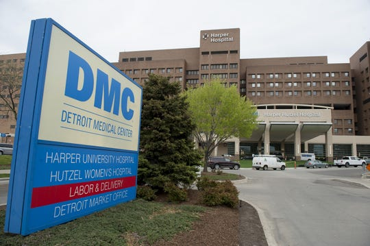 The board overseeing Detroit Medical Center's for-profit transition is sharply critical of its commitments to research and education, and its upkeep of hospitals.