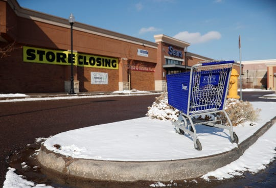 In this Tuesday, Jan. 1, 2019, file photo, an empty shopping cart sits in the snow outside a Sears store in the Streets of Southglenn mall in Littleton, Colo.