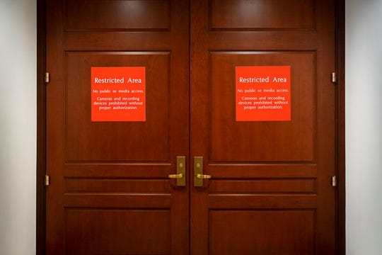 In this Nov. 6, 2019, photo, bright red signs alert non-authorized personnel at the entrance to the House SCIF, the Sensitive Compartmented Information Facility, located three levels beneath the Capitol.