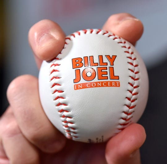 Dana Warg, VP of entertainment booking for 313 Presents, shows off a Billy Joel in Concert baseball.