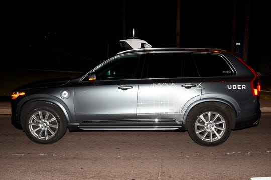 This photo provided by the Tempe Police Department shows a self-driving Uber SUV after if struck and killed a pedestrian.