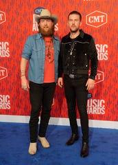 John Osborne, left, and T.J. Osborne, of Brothers Osborne, arrive at the CMT Music Awards on June 5, 2019, in Nashville, Tenn.