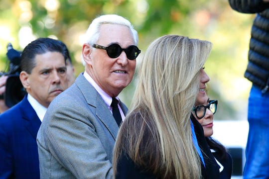 Roger Stone, center, arrives at the federal court in Washington, Tuesday, Nov. 5, 2019. Stone, a longtime Republican provocateur and former confidant of President Donald Trump, goes on trial over charges related to his alleged efforts to exploit the Russian-hacked Hillary Clinton emails for political gain.