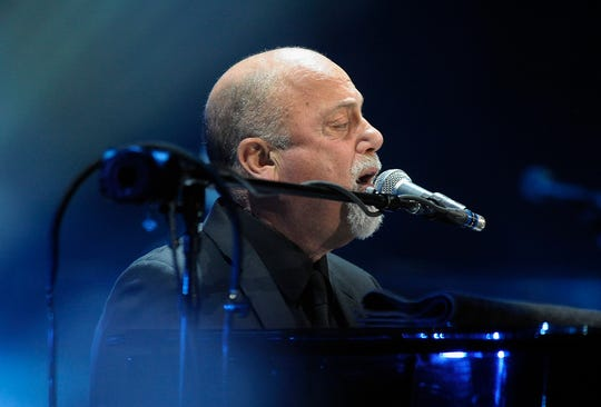 Billy Joel performs for the crowd at The Palace in Auburn Hills, Mich., Saturday, February 15, 2014.