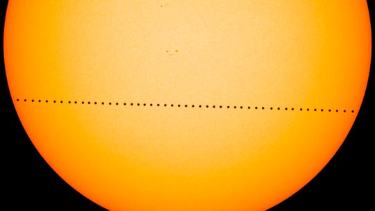 In this composite image provided by NASA, the planet Mercury passes directly between the sun and Earth on May 9, 2016 in a transit which lasted seven-and-a-half-hours. On Monday, Nov. 11, 2019, Mercury will make another transit, visible from the eastern U.S. and Canada, and all Central and South America.
