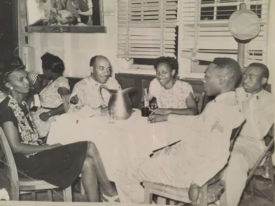 Hillard Holland Sr. is pictured in the center on a double date with his wife, Margaret Holland.