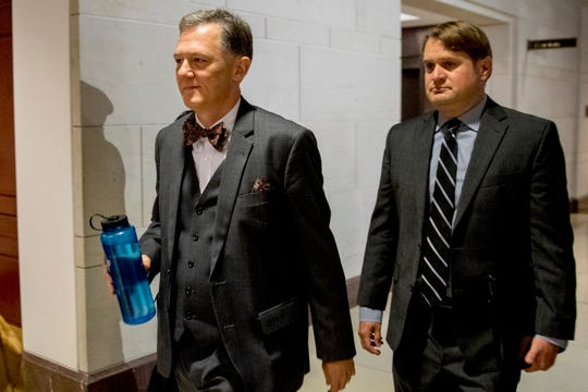FILE - In this Oct. 15, 2019, file photo, Deputy Assistant Secretary of State George Kent arrives on Capitol Hill in Washington. House impeachment investigators released a transcript from Kent, a career official at the State Department on Nov. 7.