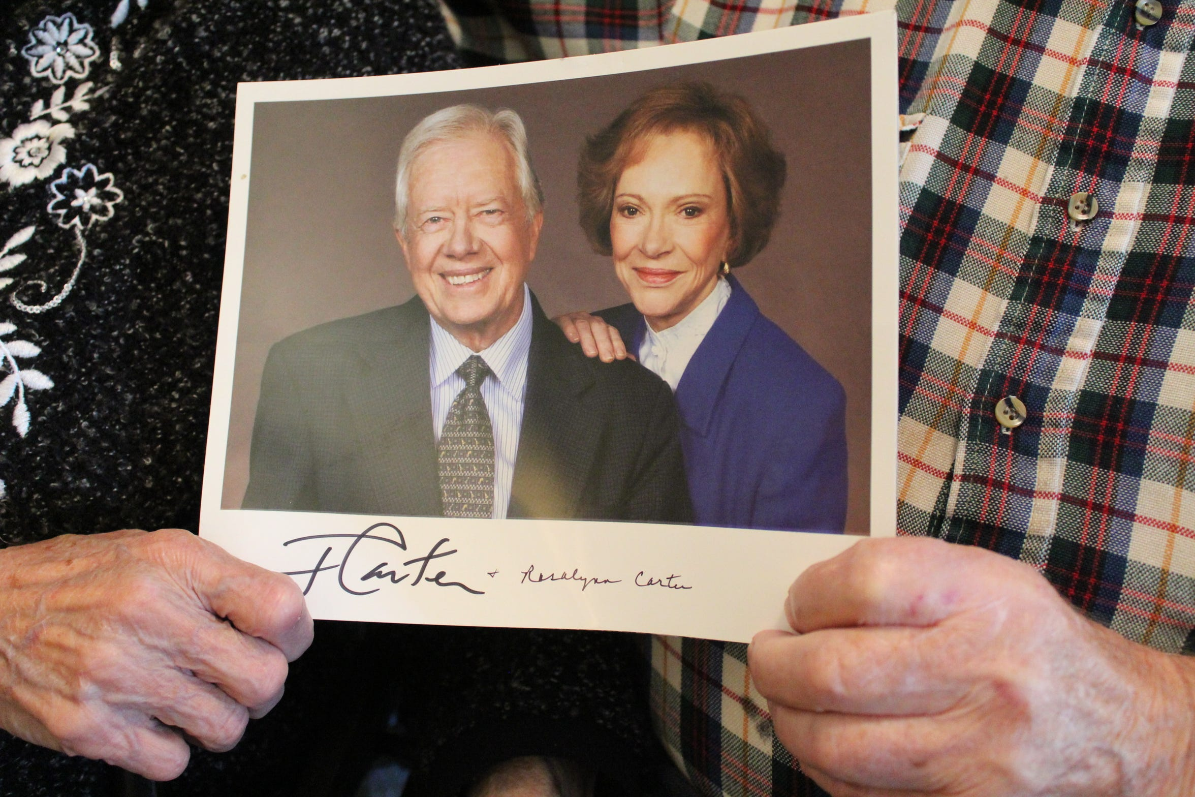 Betty and Calvin Haar of Elmore hold an autographed photo they received from former President Jimmy Carter and his wife, Rosalynn.