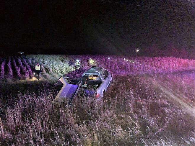 Oconto firefighters search a cornfield for the victim of a rollover crash on Highway 22 in the town of Oconto early Thursday morning.