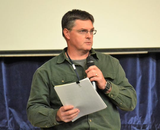 Pat Virtues, the planning znd zoning administrator for Oconto County, speaks to the crowd attending the meeting on bayshore flooding on Nov. 6 at Oconto High School.