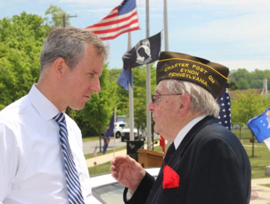 U.S. Rep. Matt Cartwright, left, says he will propose legislation to protect veterans from benefit-buying schemes.