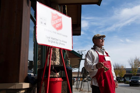 John Martin rings a bell outside Cabela's Friday, November 8, 2019 as part of the Salvation Army's Red Kettle Campaign.