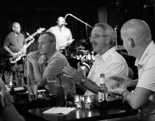 Audience members applaud during a performance by the Jazzsmiths at Blue Boulevard.