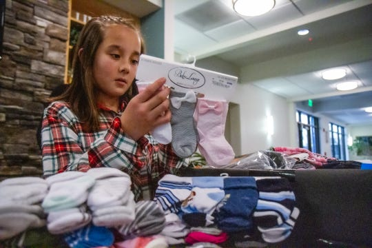"Reia Henry, a fifth grade student at Lincoln Elementary School, presented the Great Falls Rescue Mission with 834 pairs of socks on Friday, Nov. 8, 2019. Henry collected donated socks in various locations around Great Falls for her project ""Socktober."" The socks will be given as holiday gifts to sponsored families and individuals through the Family Cameron Center, as well as the Men's and Women's shelters."