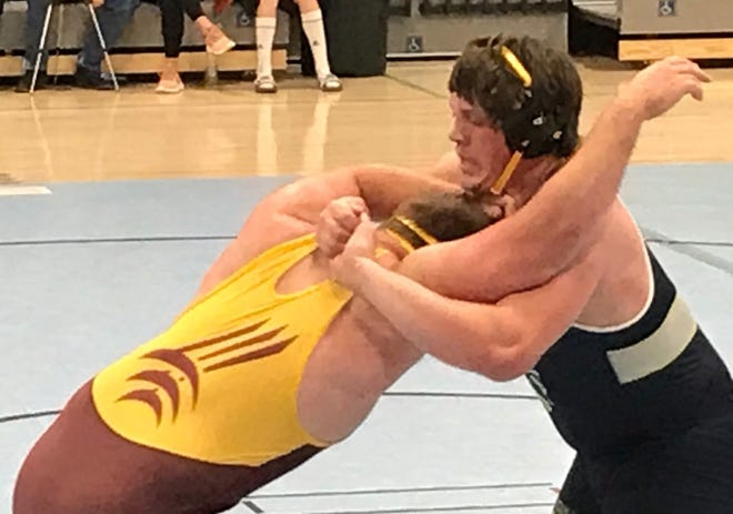Providence heavyweight wrestler KC Buday works to gain an advantage over Montana State Northern's Jase Stokes during the dual Thursday at McLaughlin Center. Stokes won by decision.