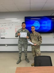 Airman Martin Borja (left) graduated Air Force Technical Training on Nov. 4 at Kessler Air Force Base. Borja will be heading to RAF Croughton, United Kingdom. He is the youngest child of Michael and Madaleine Borja of Inarajan