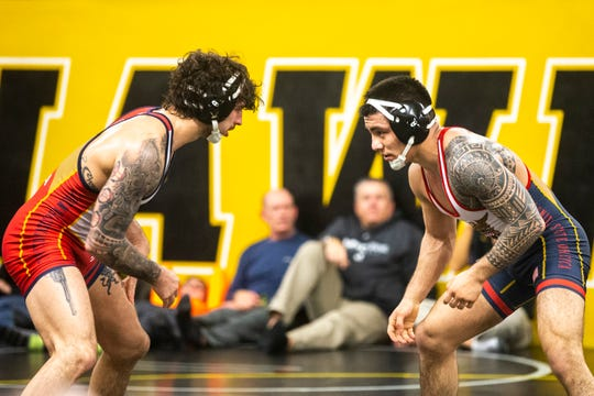 Iowa's Vince Turk, left, wrestles Pat Lugo during the second day of preseason Hawkeye wrestling matches, Friday, Nov., 8, 2019, inside the Dan Gable Wrestling Complex at Carver-Hawkeye Arena in Iowa City, Iowa.