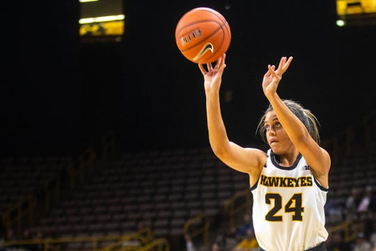 Iowa guard Gabbie Marshall (24) shoots a 3-point basket during an NCAA non-conference women's basketball game, Thursday, Nov., 7, 2019, at Carver-Hawkeye Arena in Iowa City, Iowa.