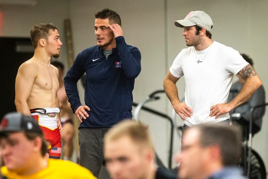 Iowa's Spencer Lee, left, talks with Mike Eierman and Jaydin Eierman during the first day of preseason Hawkeye wrestling matches, Thursday, Nov., 7, 2019, inside the Dan Gable Wrestling Complex at Carver-Hawkeye Arena in Iowa City, Iowa.