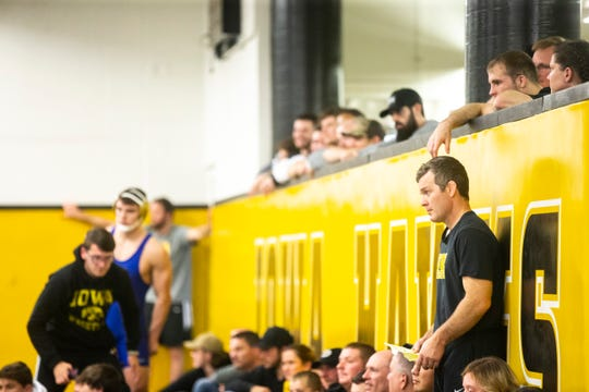 Iowa head coach Tom Brands watches a match during the second day of preseason Hawkeye wrestling matches, Friday, Nov., 8, 2019, inside the Dan Gable Wrestling Complex at Carver-Hawkeye Arena in Iowa City, Iowa.