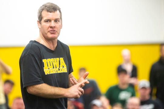 Iowa head coach Tom Brands addresses the fans during the second day of preseason Hawkeye wrestling matches, Friday, Nov., 8, 2019, inside the Dan Gable Wrestling Complex at Carver-Hawkeye Arena in Iowa City, Iowa.